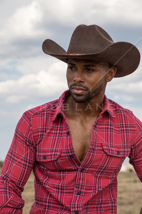 Sexy black cowboy outdoors