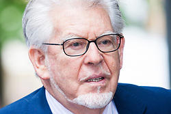 London, May 29th 2014. Veteran entertainer Rolf Harris, 84, arrives at Southwark Crown Court as his defence against 12 charges of indecent assault against four girls aged 7 to 19, continues.
