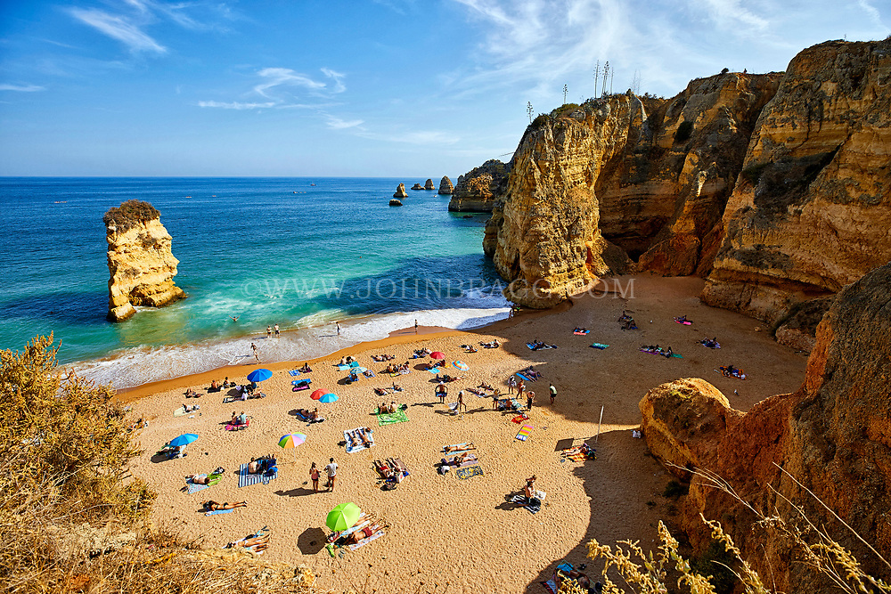 The Beach of Praia Dona Ana in the town of Lagos in the Algarve region of southern Portugal.