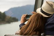 Tourists taking photo from cruise ship, Lake Todos los Santos, Los Lagos Region, Chile