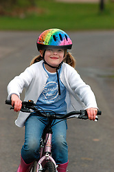 7 year old girl riding a bicycle UK