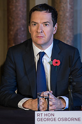 © Licensed to London News Pictures . Manchester , UK . FILE PICTURE DATED 03/11/2014 of The Chancellor of the Exchequer , GEORGE OSBORNE MP , at Manchester Town Hall signing a deal to devolve power to Greater Manchester , including giving the city a Mayor and greater control over its finances . Today (24th February 2015) it has been revealed that , as part of the devolution deal , Greater Manchester will gain control of its entire £6 billion NHS budget - 25% of the government's spending in the region , and all administrative control too . Photo credit : Joel Goodman/LNP