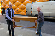 Antiques dealer and BBC Antiques Roadshow paintings expert Rupert Maas carries a table from a delivery van into his gallery in Clifford Street W1, on 27th February 2019, in London, England.