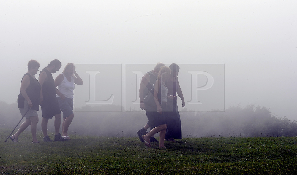 © Licensed to London News Pictures. 18/08/2012.Beachy Head mist in Eastbourne, East Sussex. The warm air from Eastbourne mixing with the cold air of Beachy Head has created a blanket of mist across the cliffs of Beachy Head this evening (18/08/2012)..This weekend is set to be the hottest of the year as temperatures are predicted at 31C (88F) as.glorious sunshine hit the South East..Photo credit : Grant Falvey/LNP