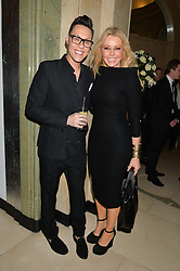 GOK WAN and CAROL VORDERMAN at the Longines World's Best Racehorse Awards 2014 hosted by Longines and the International Federation of Horseracing Authorities held at Claridge's, Brook Street, London on 20th January 2015.