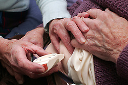 Elderly diabetic man being given insulin dose by his wife UK