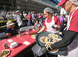 November 22, 2018 - Los Angeles, California, U.S - Volunteers serve Thanksgiving meal Thursday, Nov. 22, 2018, in Los Angeles. Thousands of Skid Row residents and homeless people from downtown and beyond were served Thanksgiving dinners during the Los Angeles Mission's annual holiday feast. (Credit Image: © Ringo Chiu/ZUMA Wire)