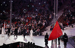 The flag of China, who are the next hosts of the Winter Paralympics in 2022, is raised during the Closing Ceremony for the PyeongChang 2018 Winter Paralympics in South Korea.