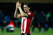 Goalscorer Lasse Vibe of Brentford claps the Brentford fans at full time. EFL Skybet football league championship match, Brentford v Sheffield Wednesday at Griffin Park in London on Saturday 30th December 2017.<br /> pic by Steffan Bowen, Andrew Orchard sports photography.