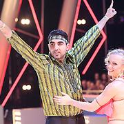 NLD/Hilversum/20130119 - 4e Liveshow Sterren Dansen op het IJs 2013, Mimoun Ouled Radi en shaatspartner Kellyn Koeplinger