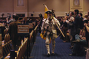 William Temple walks through the grand room dressed as a minute man during day two of the Conservative Political Action Conference (CPAC) at the Gaylord National Resort & Convention Center in National Harbor, Md.