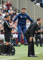Football - 2017 / 2018 Premier League - West Ham United vs Tottenham Hotspur<br /> <br /> Mauricio Pochettino, Manager of Tottenham FC, leaps into the air after a decision goes against his team at the London Stadium<br /> <br /> COLORSPORT/DANIEL BEARHAM