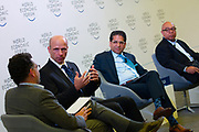 """Michael G. Jacobides, Sir Donald Gordon Chair of Entrepreneurship and Innovation, London Business School, United Kingdom, Sebastian Wedeniwski, Chief Technology Strategist, Standard Chartered Bank, Singapore,  Andrew Vaz, Global Managing Partner, Chief Innovation Officer, Deloitte, USA, Richard """"Dick"""" Daniels, Executive Vice-President; Chief Information Officer, Kaiser Permanente, USA during the session: The Future Is Platforms at the World Economic Forum - Annual Meeting of the New Champions in Tianjin, People's Republic of China 2018.Copyright by World Economic Forum / Greg Beadle"""