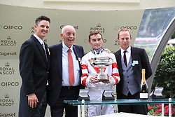 Jockey Daniel Tudhope and winning connections with the trophy for winning the Wokingham Stakes with horse Out Do