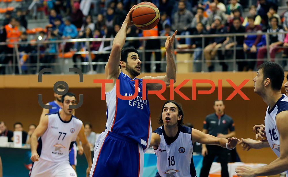 Istanbul BSB's Sasha Vujacic (2ndR) and Anadolu Efes's Dogus Balbay (L) during their Turkish Basketball League match Istanbul BSB between Anadolu Efes at Cebeci Arena in Istanbul Turkey on Monday 09 March 2015. Photo by Aykut AKICI/TURKPIX