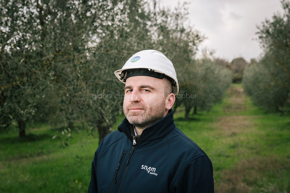 CONTURSI TERME, ITALY - 11 FEBRUARY 2020: Salvatore Ricco,  Head of Communications at Snam, poses for a portrait in Contursi Terme, Italy, on February 11th 2020.<br /> <br /> In April 2019, Snam was the first company in Europe to introduce a blend of 5% hydrogen and natural gas in its transmission network. The trial involved supplying H2NG (hydrogen-natural gas blend) for a month to two industrial companies in the area, a pasta factory and a mineral water bottling company. The trial at Contursi was repeated in December 2019, doubling the hydrogen blend to 10%.<br /> Applying a permanent 10% hydrogen blend to the total gas transported annually by Snam would mean that 7 billion cubic meters could be injected into the network each year, which is equivalent to the annual consumption of 3 million households. This would allow for a potential reduction of carbon dioxide emissions by 5 million tons.<br /> <br /> <br /> Italy is optimally positioned to become a leading hub for green hydrogen from North Africa to<br /> Europe. Italy could use its solar resources and its existing connection to North Africa (which has even better<br /> solar resources) to set up a leading hydrogen hub.<br /> <br /> Snam is one of the world's leading energy infrastructure companies and first in Europe by gas transmission network size (32,625 km in Italy, over 41,000 with international subsidiaries) and storage capacity (16.9 billion cubic meters in Italy, more than 20 bcm with international subsidiaries).<br /> <br /> In September 2018, together with other European companies, Snam signed a Hydrogen Initiative declaration to support hydrogen's potential as a sustainable energy source. The signatory companies have undertaken to gradually integrate hydrogen into gas transmission networks and to encourage their use as a solution for energy storage, as well as to support the development of hydrogen produced by electrolysis, which allows more efficient use of energy intermittent renewables.<br /> Snam