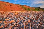 Red sandstoen cliffs and rocks along Pleasant Bay. Cape Breton Island. Cabot Trail.<br />Pleasant Bay<br />Nova Scotia<br />Canada