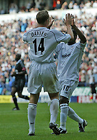 Photo. Andrew Unwin.<br /> Bolton Wanderers v Liverpool, Barclays Premiership, Reebok Stadium, Bolton 29/08/2004.<br /> Bolton's Kevin Davies (L) celebrates scoring his team's first goal with Jay Jay Okocha (R)<br /> NORWAY ONLY