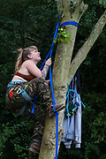 A HS2 Rebellion activist climbs a tree in Denham Country Park in order to try to protect it from works for the HS2 high-speed rail link on 8 September 2020 in Denham, United Kingdom. Anti-HS2 activists continue to try to prevent or delay works on the controversial £106bn project for which the construction phase was announced on 4th September from a series of protection camps based along the route of the line between London and Birmingham.