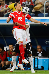 June 19, 2018 - Saint Petersburg, Russia - Artem Dzyuba (in front) of Russia national team and Mohamed Abdelshafy of Egypt national team vie for the ball during the 2018 FIFA World Cup Russia group A match between Russia and Egypt on June 19, 2018 at Saint Petersburg Stadium in Saint Petersburg, Russia. (Credit Image: © Mike Kireev/NurPhoto via ZUMA Press)