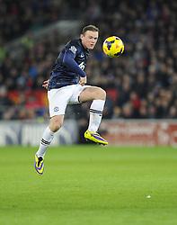 Man Utd Forward Wayne Rooney (ENG) lifts the ball through for Man Utd Forward Danny Welbeck (ENG) - Photo mandatory by-line: Joseph Meredith/JMP - Tel: Mobile: 07966 386802 - 24/11/2013 - SPORT - FOOTBALL - Cardiff City Stadium - Cardiff City v Manchester United - Barclays Premier League.