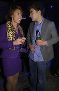 Kathy Lette with her son Julius. The Almeida Theatre Charity Christmas Gala, to raise funds for the theatre, at the Victoria Miro Gallery, London.  1 December  2005. ONE TIME USE ONLY - DO NOT ARCHIVE  © Copyright Photograph by Dafydd Jones 66 Stockwell Park Rd. London SW9 0DA Tel 020 7733 0108 www.dafjones.com