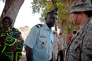 """Djiboutian police eying US Army personel...Military people from the Civil Affairs department of the US Army doing a trip to Sagallou (near Tadjoura), as part of a medical camp mission. Part of the """"3D approach"""" of the US Army : Development (in that case), Democracy, Defense...The geostrategical and geopolitical importance of the Republic of Djibouti, located on the Horn of Africa, by the Red Sea and the Gulf of Aden, and bordered by Eritrea, Ethiopia and Somalia."""