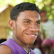 Portrait of  a smiling young papua.