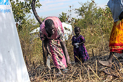 A refugee clears bush land in order to build a home. More than 300,000 South Sudanese refugees have fled from the country's civil war into Uganda since fighting broke out in July. They mostly travel by foot for days through the bush as roads have been blocked or are too dangerous to cross. The massive influx of refugees has caused a strain in humanitarian aid due to large numbers and lack of funding. BidiBidi settlement is now the third largest in the world and holds more than 210,000 people since its opening in September.