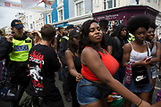 Sunday 28th August 2016 at the 50th Notting Hill Carnival in West London. A celebration of West Indian / Caribbean culture and Europes largest street party, festival and parade. Revellers come in their hundreds of thousands to have fun, dance, drink and let go in the brilliant atmosphere. It is led by members of the West Indian / Caribbean community, particularly the Trinidadian and Tobagonian British population, many of whom have lived in the area since the 1950s. The carnival has attracted up to 2 million people in the past and centres around a parade of floats, dancers and sound systems.
