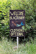 Clothing Optional sign at the dock at Blackburn Lake.  This dock is a clothing optional area at Blackburn Lake between Ganges and Fulford Harbour on Salt Spring Island, British Columbia, Canada.