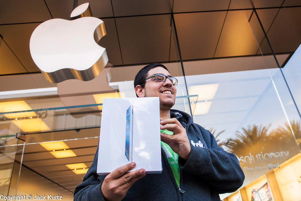 16 MARCH 2012 - SCOTTSDALE, AZ:  SCOTT BERLIN, from Tempe, AZ, shows off his brand new, still in the box, New iPad Friday. Berlin was the first person into the Apple Store in Scottsdale to buy Apple's newest consumer device. Several hundred people were in line at the Apple Store in the Scottsdale Quarter in Scottsdale, AZ, Friday to buy the New iPad.   PHOTO BY JACK KURTZ