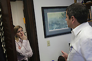 Alaska Representative Chris Tuck (D) and Aurah Landau discuss the day's strategy for moving forward Tuck's bill in his office at the capital.