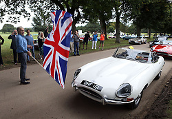Five-time Le Mans winner Derek Bell waves off the Jaguar E-type cars as they set off from Goodwood House in West Sussex on the E-type Round Britain Coastal Drive, a 3,600-mile coastal tour of Britain, in support of Prostate Cancer UK.