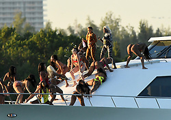 EXCLUSIVE: Rapper Cardi B. pours champagne all over twerking dancers on a yacht during a photoshoot in Miami. 03 Dec 2018 Pictured: Cardi B. Photo credit: MEGA TheMegaAgency.com +1 888 505 6342