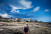 Son Serra de Marina, Mallorca, Weather forecast warns for thunderstorm coming up in the late afternoon. She returns home as the first clouds appear over the mountains. 16-08-2018