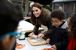 The Duchess of Cambridge helps make pizza during a visit to the King Henry's Walk Garden in Islington, London to learn about a project bringing people together through a shared love of horticulture.