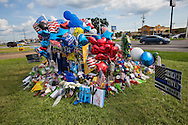 Makeshift memorial for three killed police officers in Baton Rouge at the  B-Quik gas station continues to grow.