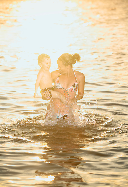 Wrightsville Beach, NC - JUNE 2: L. Beery and her son C.  play in the waters off Wrightsville Beach, NC. (Photo by Logan Mock-Bunting)