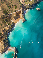 Aerial view of The Ponta da Piedade coastline with boats in the sea.