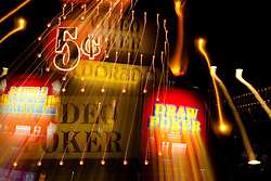 """""""5 Cent Video Poker"""" - These slot machines were photographed in a casino in Downtown Reno, Nevada. The effect was obtained in camera by long exposure mixed with intentional camera movement."""