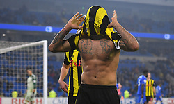 Watford's Troy Deeney celebrates scoring his side's fifth goal of the game during the Premier League match at the Cardiff City Stadium.
