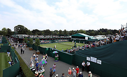 A general view of spectators watching the match action on court 12 on day three of the Wimbledon Championships at the All England Lawn Tennis and Croquet Club, Wimbledon. PRESS ASSOCIATION Photo. Picture date: Wednesday July 4, 2018. See PA story TENNIS Wimbledon. Photo credit should read: Steven Paston/PA Wire. RESTRICTIONS: Editorial use only. No commercial use without prior written consent of the AELTC. Still image use only - no moving images to emulate broadcast. No superimposing or removal of sponsor/ad logos. Call +44 (0)1158 447447 for further information.