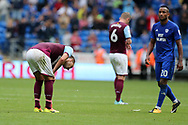 John Terry, the Aston Villa captain (l) slumps dejected at the end of the match after his team lose the match by three goals to nil. EFL Skybet championship match, Cardiff city v Aston Villa at the Cardiff City Stadium in Cardiff, South Wales on Saturday 12th August 2017.<br /> pic by Andrew Orchard, Andrew Orchard sports photography.