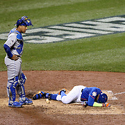 Catcher Salvador Perez, Kansas City Royals, stands over Yoenis Cespedes, New York Mets, who was hit by a pitch during the New York Mets Vs Kansas City Royals, Game 5 of the MLB World Series at Citi Field, Queens, New York. USA. 1st November 2015. Photo Tim Clayton