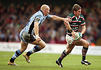 Photo: Rich Eaton.<br /> <br /> Cardiff Blues v Leicester Tigers. Heineken Cup. 29/10/2006. Ollie Smith right of Tigers is tackled by Tom Shanklin of Blues