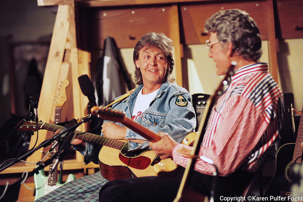 Paul McCartney and Carl Perkins play before a concert in Memphis in 1993.