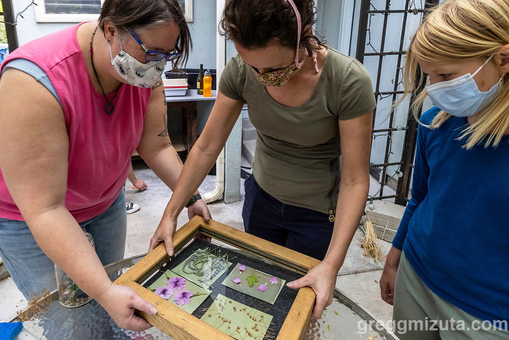 (L to R: Jessie Swimeley, Allicia Keefe, Evelyn Keefe). Jessie Swimeley's Pandemic in Blue Take Two! 5' x 7' cyanotype mural. September 18, 2021 at Surel's Place in Garden City, Idaho.
