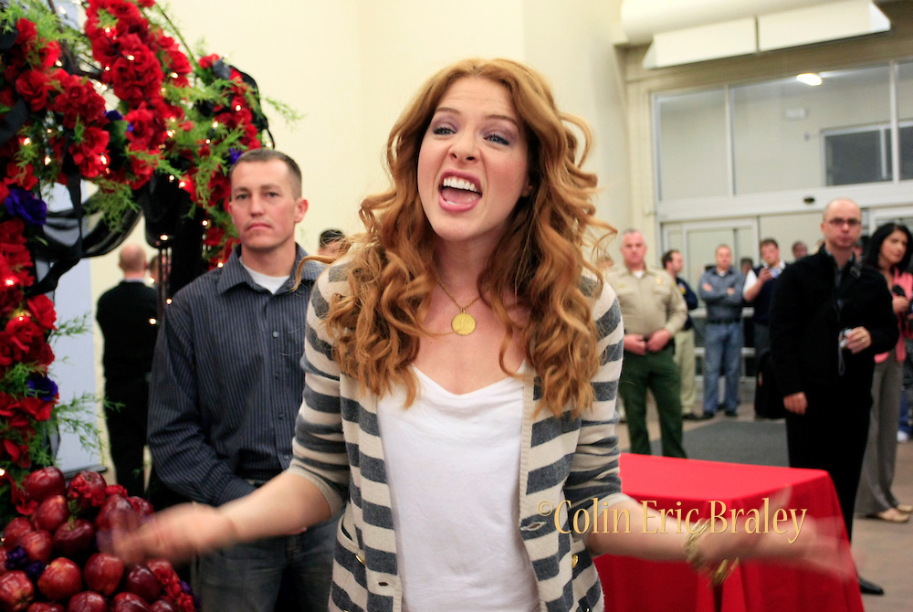 Twilight star Rachelle Lefevre, who plays character Victoria, talks to the fans gathered at the Walmart store in Riverton, Utah during the midnight DVD movie release event March 21, 2009. (AP Photo/Colin Braley)