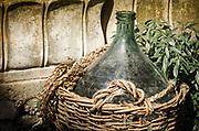 Traditional wine jug in a basket, Riomaggiore, Cinque Terre, Liguria, Italy